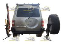 Бампер задний на УАЗ Патриот ЭВОЛЮЦИЯ с кронштейном запаски, с держателем Hi-Jack, топора и лопаты, с буксирными петлями, с возможностью подъёма Hi-Jack